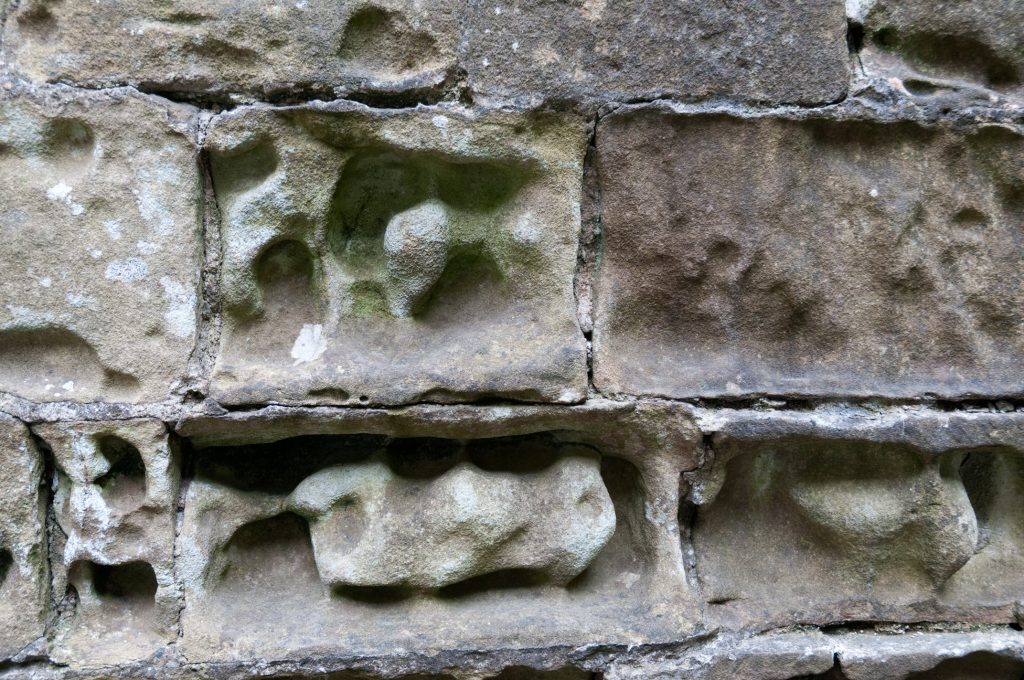 Limestone bricks dissolved by chemical weathering